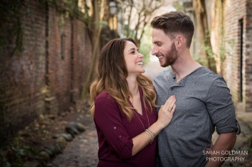 engaged couple during their photo session in Philadelphia alley