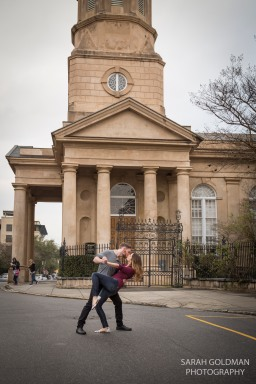 engaged couple on church street in charleston