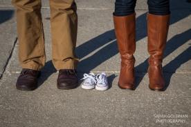 parents with tiny shoes adoption photos