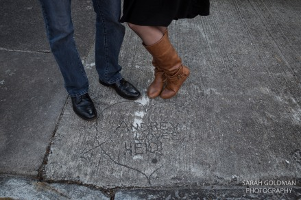 heart in the cement with lovers names