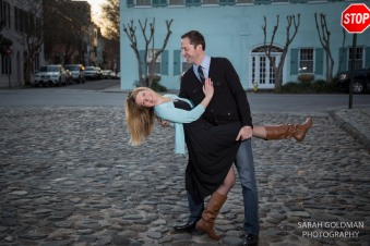 engaged couple on cobblestone street
