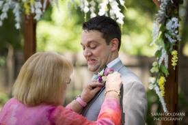 groom getting his flowers pinned on