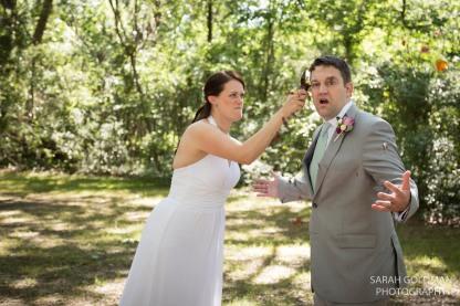 bride breaking bottle over grooms head at charleston wedding