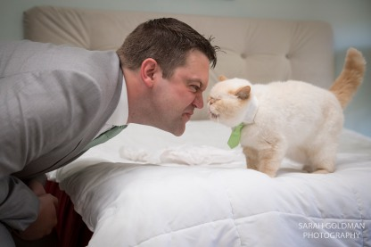 groom with his cat before wedding