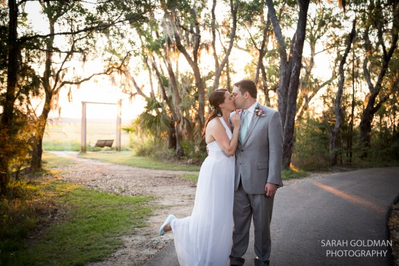 bride and groom kissing at james island county park
