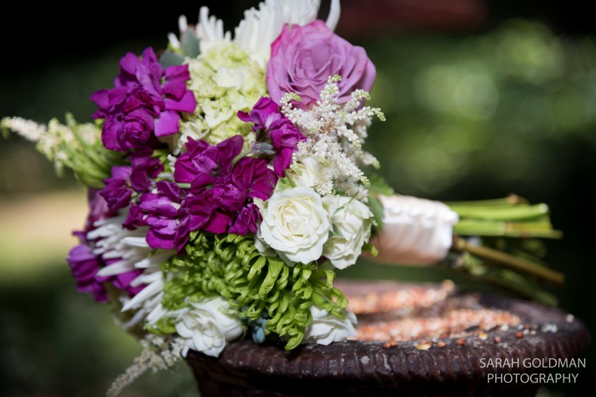 flower bouquet at backyard wedding ceremony