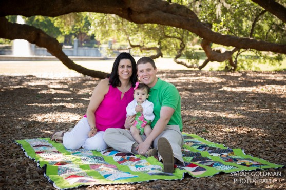 family in hampton park sitting on quilt