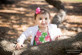 baby playing near live oak tree
