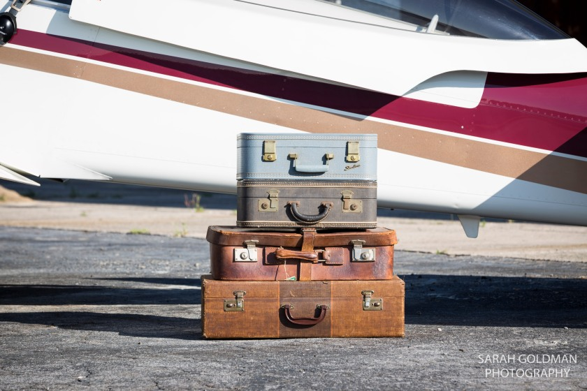 vintage suitcases in front of plane
