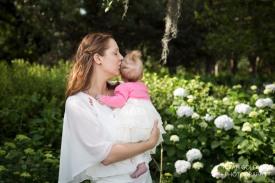 mom with baby girl by hydrangeas