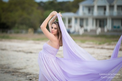 girl holding purple gown during maternity shoot