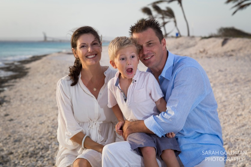 young family at the beach during photo session