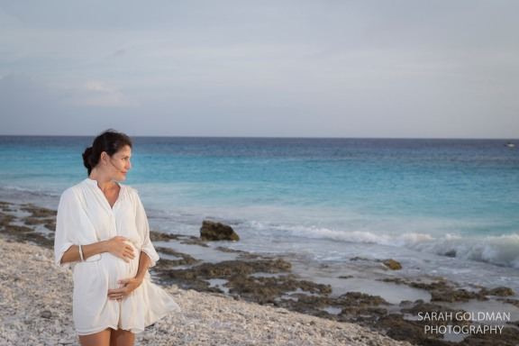 beach maternity photos with blue water