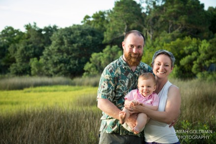 young family standing in front of salt marsh