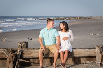 couple at the beach in charleston for maternity photos