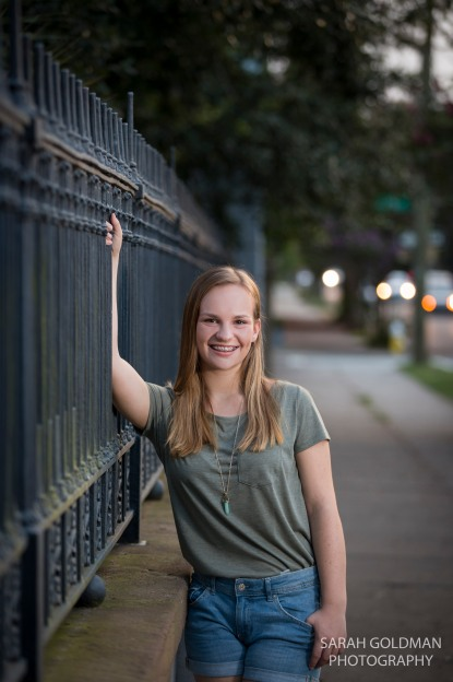 senior photo with ironwork in downtown charleston