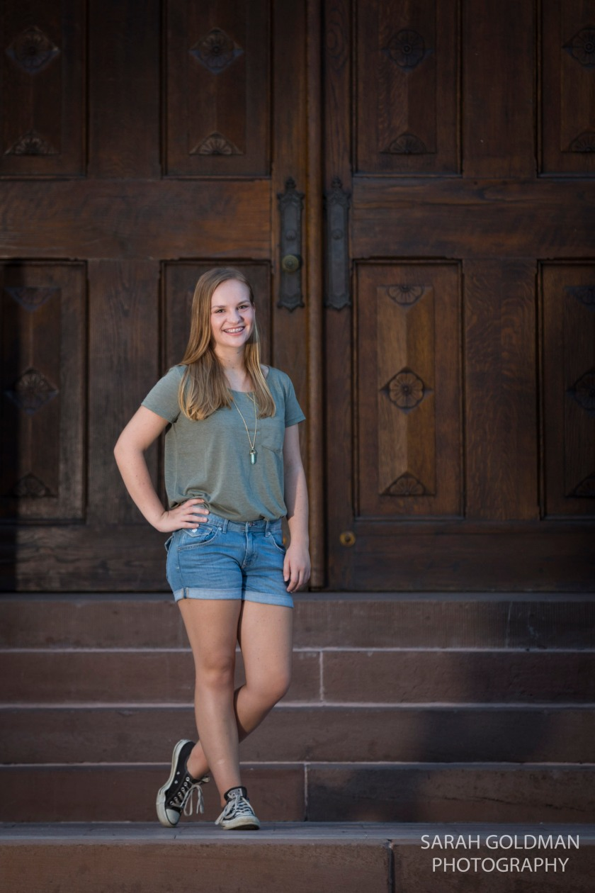 senior photos in front of church doors