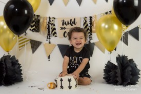 black and gold theme cake smash