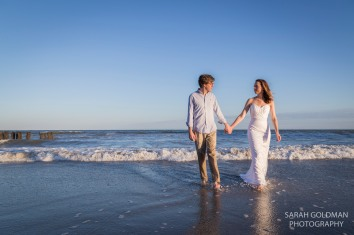 bride and groom in ocean in Charleston, SC
