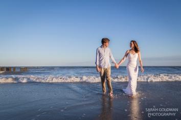 bride and groom in ocean in Charleston, SC