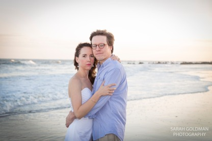 couple during their anniversary session at the beach