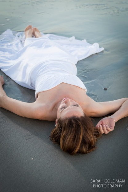 bride laying on the beach