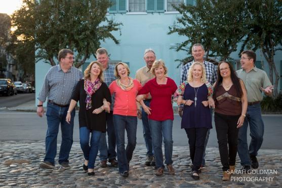family photo on cobblestone street