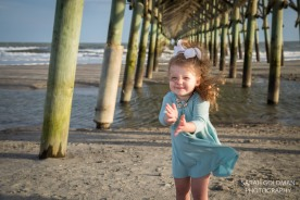 little girl playing at folly beach
