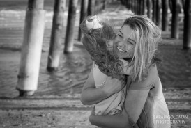 girl with her mom at the beach in charleston