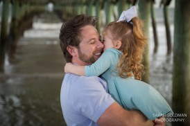 father and daughter hugging at the beach