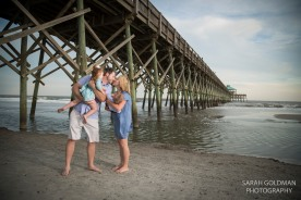 family at folly beach fishing pier