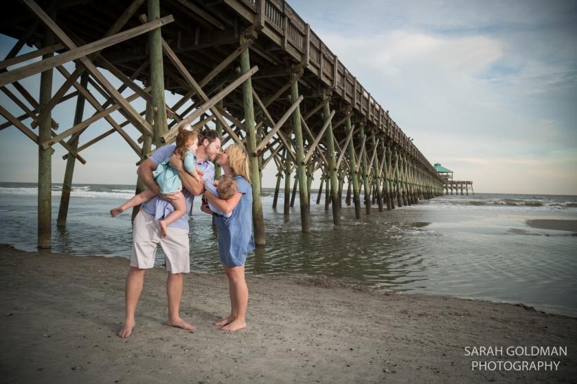 family at folly beach fishing pier