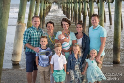 large family photo under folly pier
