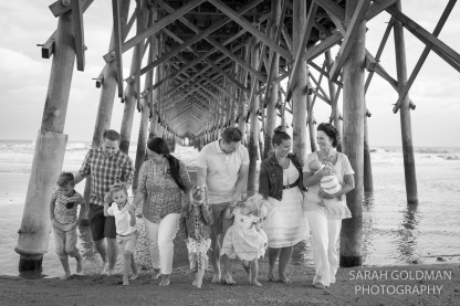 lifestyle black and white photo of a family at folly beach