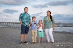 family with 2 young boys at folly beach fishing pier