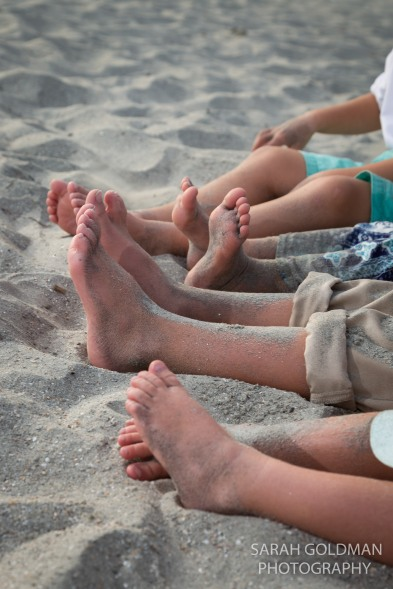 kids bare feet in the sand