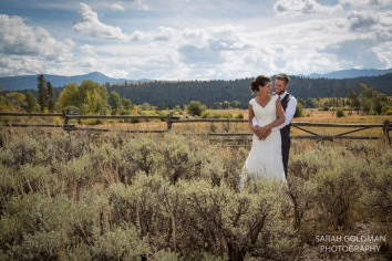 bride and groom with sage brush and fence