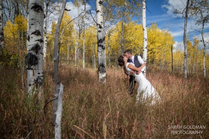 bride and groom with aspen trees