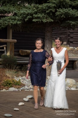 bride and her mother walk down the aisle