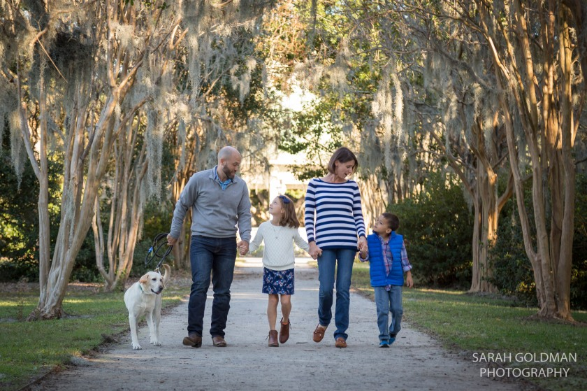 family walking along tree-lined path in charleston sc