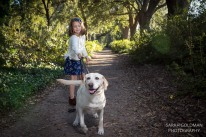 girl with yellow lab in the park