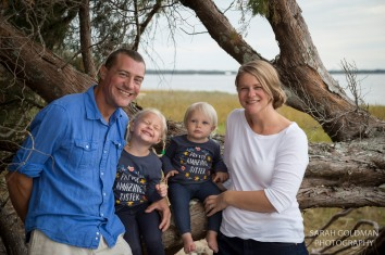 young family smiling for family photos in charleston sc