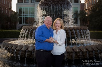 grandparents in front of pineapple fountain