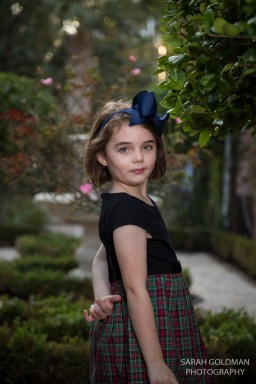 little girl poses in rose garden in charleston