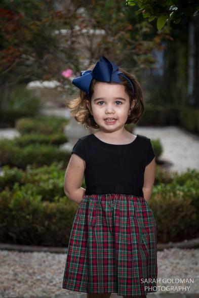 little girl in a charleston garden
