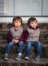 boys sitting on front porch