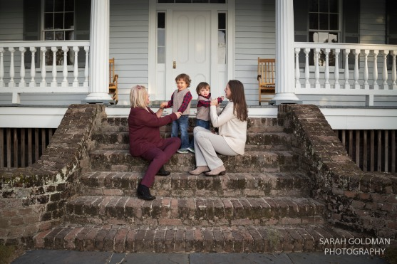 family playing on steps of mcleod plantation