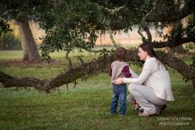 mom and son near a live oak