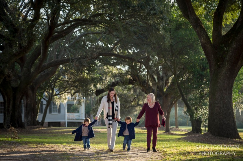 family walking in row of live oaks in charleston sc