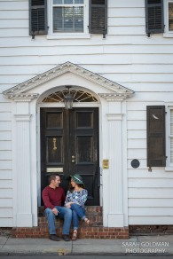 couple sitting on steps of downtown Charleston house